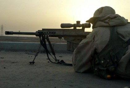 A SNIPER OF US MARINE EXPEDITIONARY UNIT TAKES AIM IN PORT CITY OF UMM-QASR