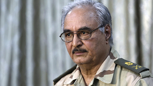 General Khalifa Haftar attends a news conference at a sports club in Abyar, a small town to the east of Benghazi in this May 17, 2014 file photo. Growing frustration over the reality of life in eastern Libya, which contrasts with the promises of politicians, is feeding support for Haftar, who has set himself up as a warrior against Islamist militancy and who some also see as their saviour. REUTERS/Esam Al-Fetori/Files (LIBYA - Tags: MILITARY HEADSHOT POLITICS CIVIL UNREST)