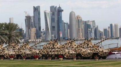 A general view show armoured vehicles rolling during the military parade marking the Gulf emirate's National Day celebrations in Doha on December 18, 2012. AFP PHOTO / KARIM JAAFAR / AL-WATAN DOHA == QATAR OUT ==