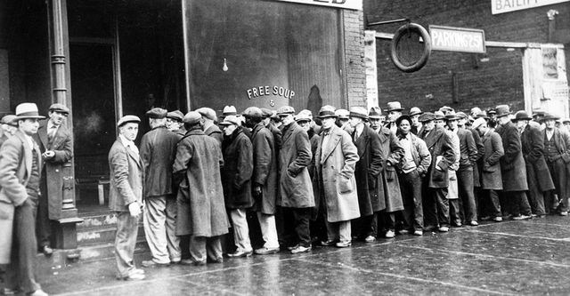 The Great Depression. Unemployed men queued outside a soup kitchen opened in Chicago by Al Capone. The storefront sign reads Free Soup, Coffee and Doughnuts for the Unemployed. Chicago, 1930s (Newscom TagID: evhistorypix027753.jpg) [Photo via Newscom]