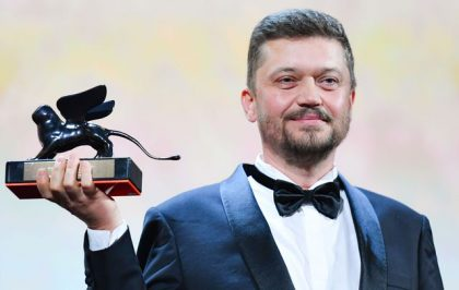 "Ukrainian director Valentyn Vasyanovych holds the Orizzonti award for Best Film he received for the film ""Atlantis"" during the awards ceremony of the 76th Venice Film Festival on September 7, 2019 at Venice Lido.  / AFP / Alberto PIZZOLI"